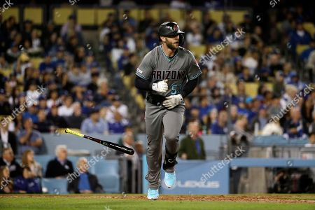Arizona Diamondbacks' Christian Walker drops his bat after hitting a three-run home run against the Los Angeles Dodgers during the seventh inning of a baseball game, in Los Angeles