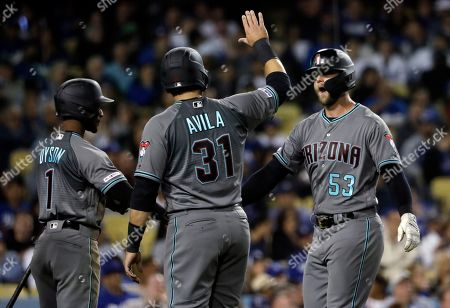 Christian Walker, Alex Avila, Jarrod Dyson. Arizona Diamondbacks' Christian Walker, right, is met at home plate by teammates Alex Avila and Jarrod Dyson after Walker's three-run home run against the Los Angeles Dodgers during the seventh inning of a baseball game, in Los Angeles