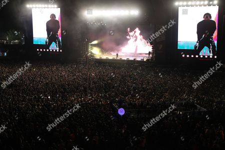 People attend the performance of US rapper Kendrick Lamar during the Lollapalooza Chile 2019 Festival in Santiago, Chile, 29 March 2019.