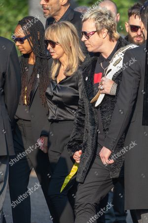 Natalie Appleton and Liam Howlett at the funeral of Keith Flint today (Fri). Crowds packed the road between Braintree in Essex and St Mary's Church in Bocking, where the service was held.