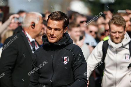 Fulham caretaker manager Scott Parker arriving at Craven Cottage, followed by Fulham forward Andre Schurrle (14), before the Premier League match between Fulham and Manchester City at Craven Cottage, London