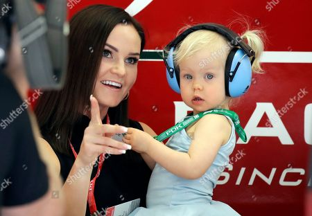 Minttu Virtanen and daughter Rianna, the wife and daughter of Alfa Romeo driver Kimi Raikkonen of Finland attend the third free practice at the Formula One Bahrain International Circuit in Sakhir, Bahrain, . The Bahrain Formula One Grand Prix will take place on Sunday