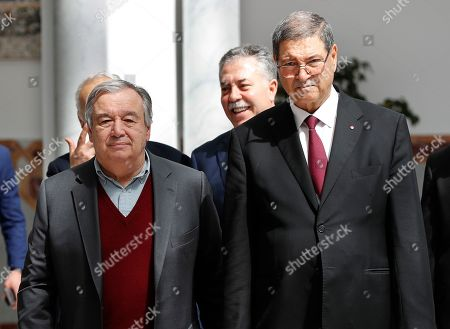 United Nations Secretary General Antonio Guterres, left, and Tunisian Presidential Advisor for political affairs, Habib Essid, right, arrive at Tunis-Carthage international airport to attend the Arab Summit, in Tunis, Tunisia, . Arab leaders meeting in Tunisia on Sunday hope to project unified opposition to the Trump administration's acceptance of Israeli control over the Golan Heights and Jerusalem, but as with past Arab League summits, the gathering is likely to expose their own bitter rivalries