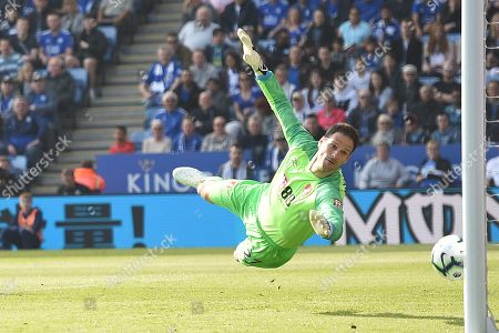 Goal keeper Asmir Begovic of AFC Bournemouth dives for the shot of Wes Morgan of Leicester City.