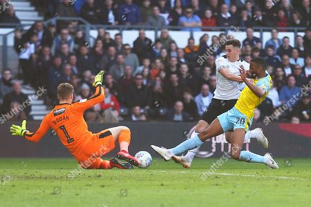 Derby County forward Tom Lawrence (10) is fouled by Rotherham United defender Michael Ihiekwe (20) and a penalty is awarded during the EFL Sky Bet Championship match between Derby County and Rotherham United at the Pride Park, Derby