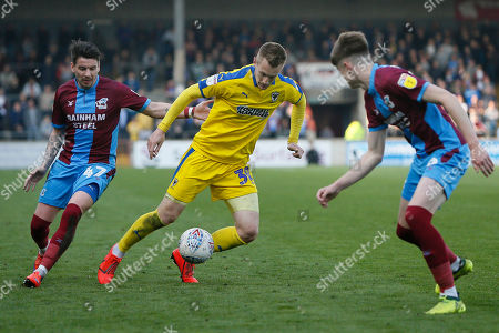 Wimbledon forward Joe Pigott (39) goes past Scunthorpe United defender Tom Pearce (16)  during the EFL Sky Bet League 1 match between Scunthorpe United and AFC Wimbledon at Glanford Park, Scunthorpe