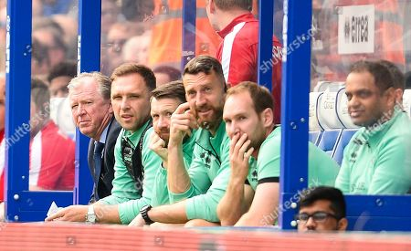 Steve McClaren manager of QPR on the bench with his team