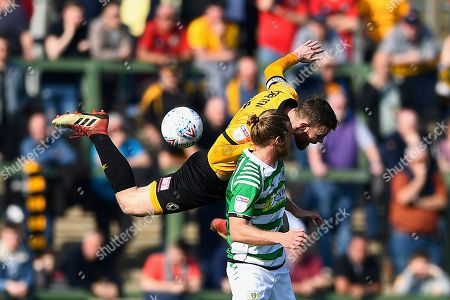 Mark O'Brien of Newport County wins a header from Alex Fisher of Yeovil Town  during Yeovil Town vs Newport County, Sky Bet EFL League 2 Football at Huish Park on 30th March 2019