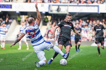 Bolton Wanderers midfielder Gary O'Neil (19) and Queens Park Rangers Defender Toni Leistner (37) battle for the ball during the EFL Sky Bet Championship match between Queens Park Rangers and Bolton Wanderers at the Loftus Road Stadium, London