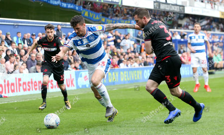 Pawel Wszolek of QPR  attacks Andrew Taylor of Bolton Wanderers
