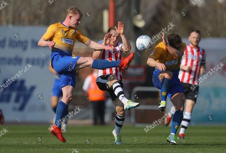 Matt Jay of Exeter City in action against Willem Tomlinson and Alex MacDonald of Mansfield Town