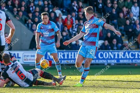 Stock Picture of Gary MacKenzie of St Mirren dives in to block the shot of Andy Nelson of Dundee FC during the Ladbrokes Scottish Premiership match between St Mirren and Dundee at the Paisley 2021 Stadium, St Mirren