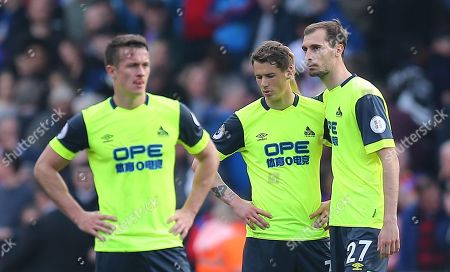Jon Gorenc-Stankovic of Huddersfield and  Erik Durm of Huddersfield dejected after their team is being relegated