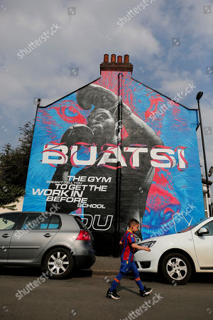 A mural of boxer and Crystal Palace fan  Joshua Buatsi painted at the bottom of Holmesdale Road