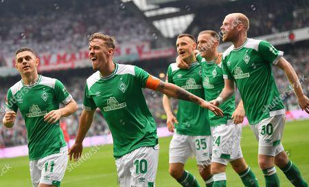 Bremen's Milot Rashica, Max Kruse, Maximilian Eggestein, Johannes Eggestein and Davy Klaassen (L-R) are celebrating during the German Bundesliga soccer match between SV Werder Bremen and 1. FSV Mainz 05 in Bremen, Germany, 30 March 2018.