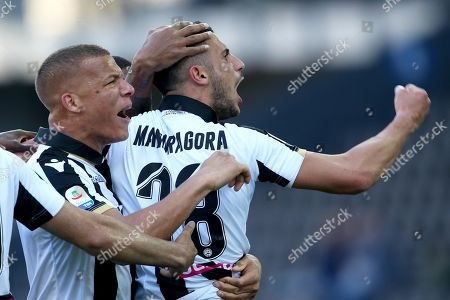 Udinese's Rolando Mandragora (R) jubilates with his teammate William Troost-Ekong (L) after scoring the 2-0 goal during the Italian Serie A soccer match Udinese Calcio vs Genoa CFC at Friuli stadium in Udine, Italy, 30 March 2019.