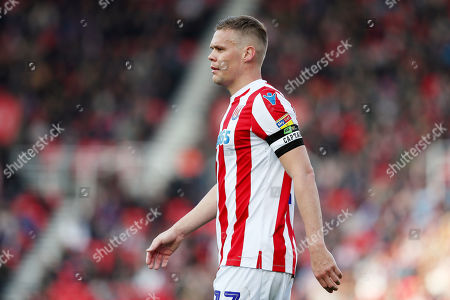 Ryan Shawcross of Stoke City wears the captain armband with Kick it Out branding