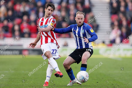 Bojan Krkic of Stoke City and Barry Bannan of Sheffield Wednesday