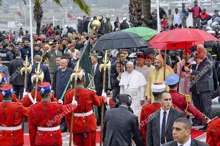 Pope Francis (L) and King Mohammed VI (R) walk on the Esplanade of the Hassan Tower in Rabat, Morocco, 30 March 2019. Pope Francis is on the apostolic journey to Morocco to highlight the North African nation's tradition of Christian-Muslim ties.