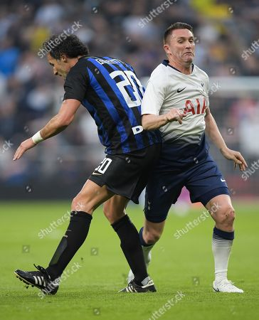 Fabio Galante of Inter Forever runs into Robbie Keane of Spurs Legends