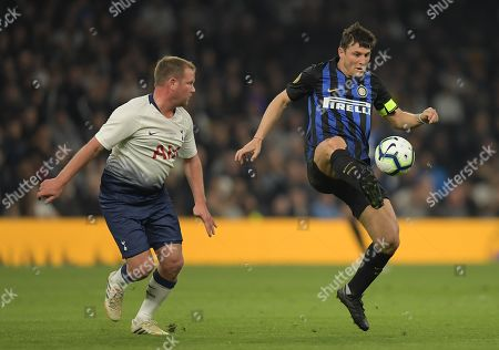 Teemu Tainio of Spurs Legends and Javier Zanetti of Inter Forever
