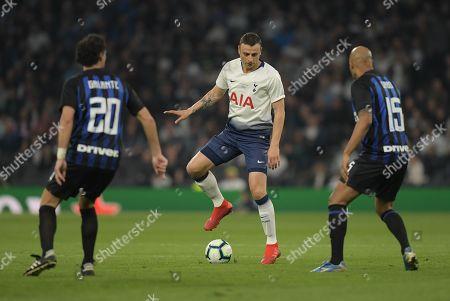 Dimitar Berbatov of Spurs Legends runs past Fabio Galante of Inter Forever