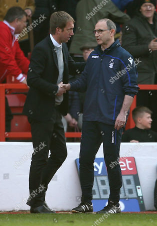 Swansea City Manager Graham Potter and Nottingham Forest Manager Martin O'Neill at full time.