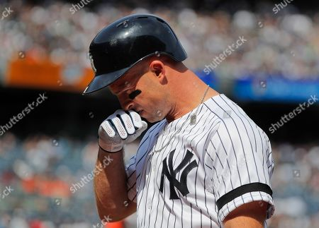 New York Yankees left fielder Brett Gardner (11) walks off the field after flying out against the Baltimore Orioles during a baseball game, in New York