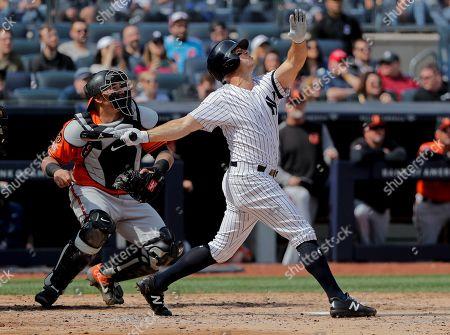 New York Yankees left fielder Brett Gardner (11) pops up against the Baltimore Orioles during a baseball game, in New York