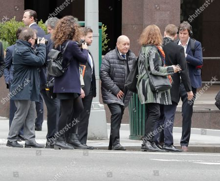 Jean-Yves Le Drian, Minister for Europe and Foreign Affairs of France help save the planet by walking with his Ambassador Francois Delattre and delegation to the UN Headquarters in New York for his meetings.