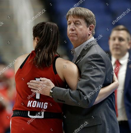 Wes Moore, Aislinn Konig. North Carolina State head coach Wes Moore, right, hugs Aislinn Konig (1) during the second half of a regional women's college basketball game against Iowa in the NCAA Tournament in Greensboro, N.C