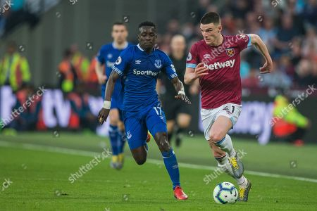 Declan Rice (West Ham) with the ball pursued by Idrissa Gana Gueye (Everton) during the Premier League match between West Ham United and Everton at the London Stadium, London