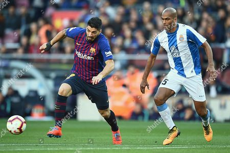 Luis Suarez of FC Barcelona and Edinaldo Gomes Naldo of RCD Espanyol during the match between FC Barcelona v RCD Espanyol of LaLiga, date 29, 2018-2019 season. Camp Nou Stadium. Barcelona, Spain - 30 MAR 2019.