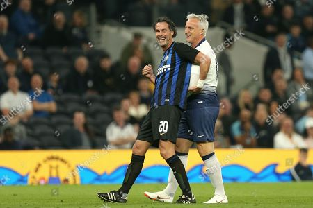 David Ginola of Spurs Legends and David Suazo of Inter Forever share a joke during Spurs Legends vs Inter Forever, Test Event Match Two Football at Tottenham Hotspur Stadium on 30th March 2019