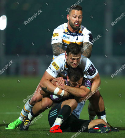Worcester Warriors vs Harlequins. Harlequins' Danny Care is tackled by Ryan Mills and Francois Hougaard of Worcester
