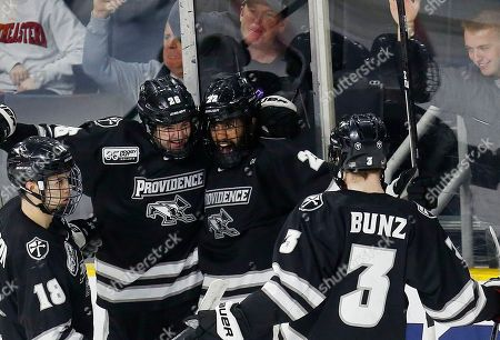 Vimal Sukumaran, Jacob Bryson, John McDermott, Davis Bunz. Providence's Vimal Sukumaran (22) celebrates his goal with teammates Jacob Bryson (18), John McDermott (26) and Davis Bunz (3) during the second period of an NCAA Division I East Regional semifinal men's hockey game against Minnesota State in Providence, R.I