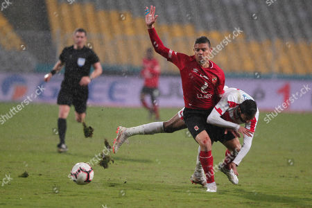 Al-Zamalek player Mahmoud Kahraba (R) ights for the ball with Al-Ahly players Saad Samir (C) and Marwan Mohsen (L) during the Egyptian Premier League soccer match between Al-Ahly and Al-Zamalek at Borg Al Arab stadium, Cairo, Egypt, 30 March 2018.
