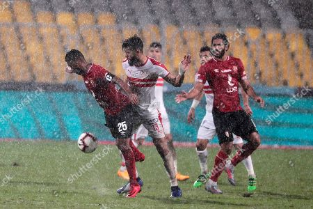 Al-Zamalek player Fergany Sasi(c) fights for the ball with Al-Ahly playersHossam shour  (l) and Marwan Mohsen (L)during the Egyptian Premier League soccer match between Al-Ahly and Al-Zamalek at Borg Al Arab stadium, Cairo, Egypt, 30 March 2018.