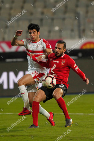 Al-Zamalek player zizi (l) fights for the ball with Al-Ahly players Ali Maloul (r) and Marwan Mohsen (L)during the Egyptian Premier League soccer match between Al-Ahly and Al-Zamalek at Borg Al Arab stadium, Egypt, 30 March 2019.