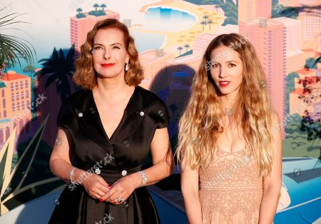 Carole Bouquet (L) and Charlotte Giacobetti (R) arrive for the 'Bal de la Rose' (Rose Ball), in Monaco, 30 March 2019. The Rose Ball is a traditional annual charity event in the Principality of Monaco. This year the theme is 'Riviera', designed by late German Karl Lagerfeld and Princess Caroline of Hanover.