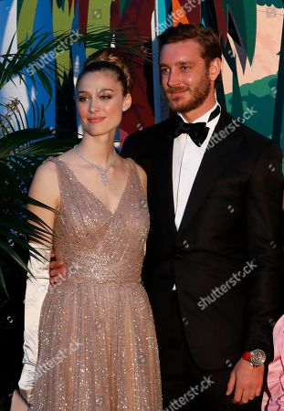 Pierre Casiraghi (R) and his wife countess Beatrice Boromeo (L) arrive for the 'Bal de la Rose' (Rose Ball), in Monaco, 30 March 2019. The Rose Ball is a traditional annual charity event in the Principality of Monaco. This year the theme is 'Riviera', designed by late German Karl Lagerfeld and Princess Caroline of Hanover.