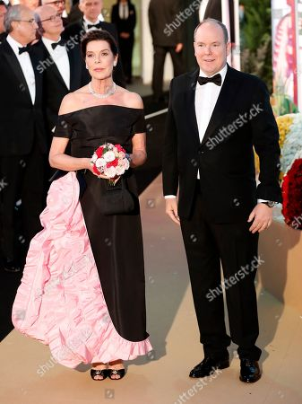 Prince Albert II of Monaco (R) and Princess Caroline of Hanover (L) arrive for the 'Bal de la Rose' (Rose Ball), in Monaco, 30 March 2019. The Rose Ball is a traditional annual charity event in the Principality of Monaco. This year the theme is 'Riviera', designed by late German Karl Lagerfeld and Princess Caroline of Hanover.