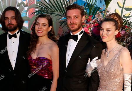 Dimitri Rassam (L), Charlotte Casiraghi (2-L), Pierre Casiraghi (2-R) and his wife countess Beatrice Boromeo (R) arrive for the 'Bal de la Rose' (Rose Ball), in Monaco, 30 March 2019. The Rose Ball is a traditional annual charity event in the Principality of Monaco. This year the theme is 'Riviera', designed by late German Karl Lagerfeld and Princess Caroline of Hanover.