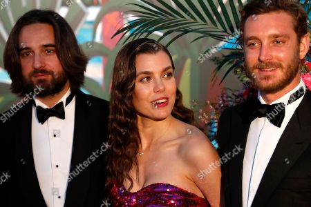Dimitri Rassam (L), Charlotte Casiraghi (C) and Pierre Casiraghi (R) arrive for the 'Bal de la Rose' (Rose Ball), in Monaco, 30 March 2019. The Rose Ball is a traditional annual charity event in the Principality of Monaco. This year the theme is 'Riviera', designed by late German Karl Lagerfeld and Princess Caroline of Hanover.
