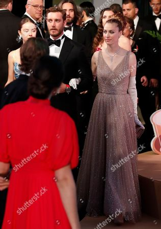 Princess Alexandra of Hanover (L), Pierre Casiraghi (C) and his wife countess Beatrice Boromeo (R) arrive for the 'Bal de la Rose' (Rose Ball), in Monaco, 30 March 2019. The Rose Ball is a traditional annual charity event in the Principality of Monaco. This year the theme is 'Riviera', designed by late German Karl Lagerfeld and Princess Caroline of Hanover.