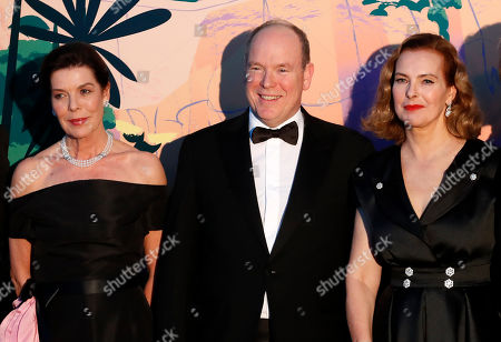 Prince Albert II of Monaco (C), Princess Caroline of Hanover (L) and French actress Carole Bouquet (R) arrive for the 'Bal de la Rose' (Rose Ball), in Monaco, 30 March 2019. The Rose Ball is a traditional annual charity event in the Principality of Monaco. This year the theme is 'Riviera', designed by late German Karl Lagerfeld and Princess Caroline of Hanover.