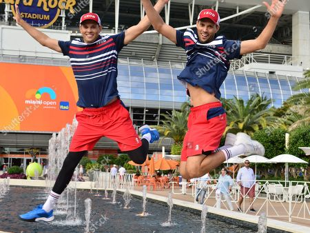 Bob Bryan and Mike Bryan, of USA hold the winners trophy after defeating Wesley Koolhof of Netherlands and Stefanos Tsitsipas of Greece in the doubles final
