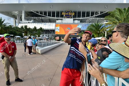 Bob Bryan, of USA poses for selfie with fans after the trophy portrait