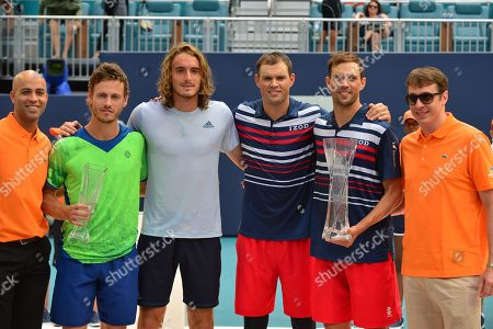 James Blake, Wesley Koolhof of Netherlands and Stefanos Tsitsipas of Greece and Bob Bryan and Mike Bryan of USA pose for trophy after they double match