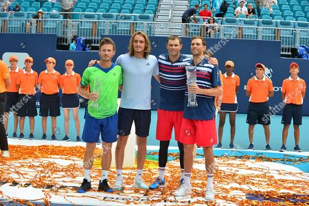 Wesley Koolhof of Netherlands and Stefanos Tsitsipas of Greece and Bob Bryan and Mike Bryan of USA pose for trophy after they double match